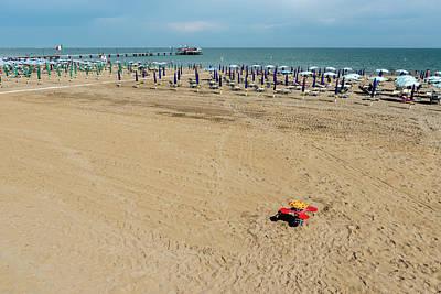 Man Cave - Play on the beach by Nicola Simeoni