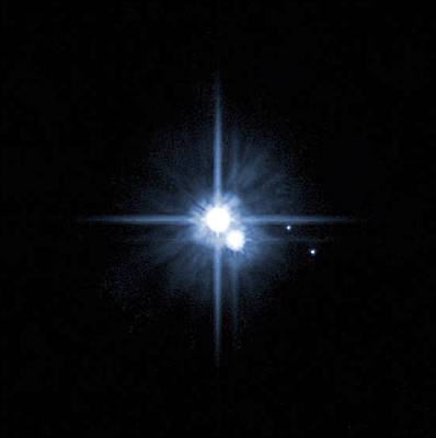 Radiant Image Photograph - Pluto And Its Moons Charon, Hydra by Stocktrek Images