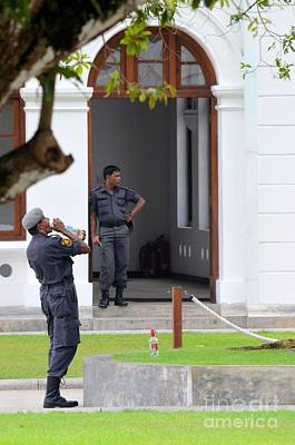 Photograph - Police Officers Guard And Drink Water At Arcade Independence Square Colombo Sri Lanka  by Imran Ahmed