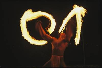 Fire Dance Photograph - Polynesian Dancer Twirls Torches by Tim Laman