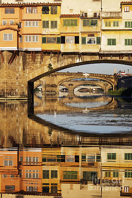 Ponte Vecchio Crossing The River A Art Print by Jeremy Woodhouse