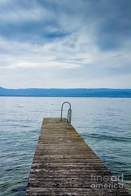 Horizon Over Sea Photograph - Pontoon On Lake Geneva. Haute-savoie. France. by Bernard Jaubert