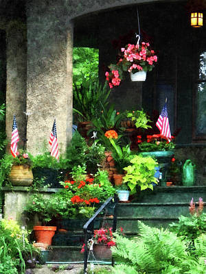 Photograph - Porch With Geraniums And American Flags by Susan Savad