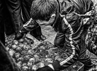 Photograph - Potato Worker Moving Sacks by John Williams