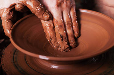 Artist Working Photograph - Potter Shaping Clay On The Pottery Wheel by Alim Yakubov