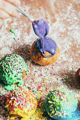 Photograph - Pouring A Lilac Frosting On The Round Fried Donut. by Michal Bednarek