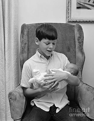 Little Sister Photograph - Pre-teen Boy Holding New Sister, C.1960s by H. Armstrong Roberts/ClassicStock