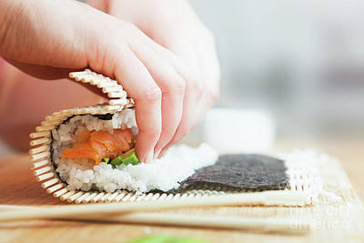 Master Photograph - Preparing, Rolling Sushi. Salmon, Avocado, Rice And Chopsticks On Wooden Table by Michal Bednarek