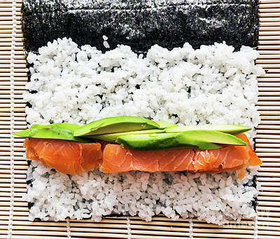 Lunch Photograph - Preparing Sushi Background. Salmon, Avocado, Rice On Seaweed by Michal Bednarek
