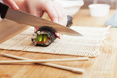Dinner Photograph - Preparing Sushi, Cutting. Salmon, Avocado, Rice And Chopsticks On Wooden Table by Michal Bednarek