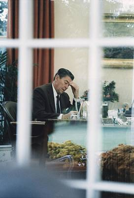 President Reagan Working In The Oval Print by Everett