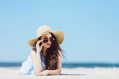 Photograph - Pretty Girl In Straw Hat Laying On The Sandy Beach by Michal Bednarek