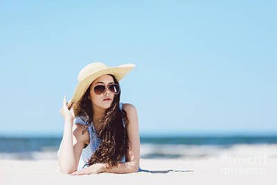 Photograph - Pretty Girl Laying On The Beach, Wearing Hat And Sunglasses. by Michal Bednarek