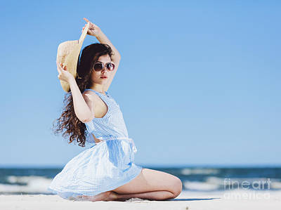 Photograph - Pretty Girl Sitting On A Sandy Beach By The Blue Sea. by Michal Bednarek