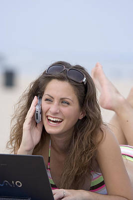 Girl Photograph - Pretty Girl Using Laptop And Cell Phone At Beach by Christopher Purcell