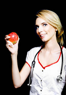 Pretty Nurse Shows The Benefits Of Eating Properly Art Print by Jorgo Photography - Wall Art Gallery
