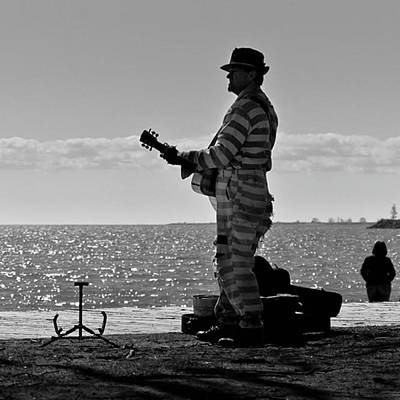 Musician Wall Art - Photograph - Prison Break Blues.  Busking On The by Brian Carson
