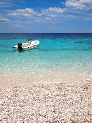 Photograph - Private Beach With Speedboat by IPics Photography