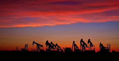 Photograph - Pumpjacks At Sunset by John Babis