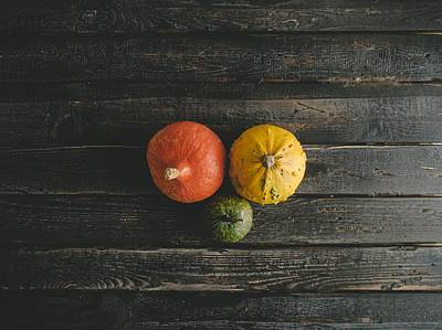 Photograph - Pumpkins On A Wooden Table by Fine Art Photography