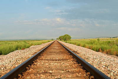 Photograph - Railway Tracks Disappearing Into The Distance. by Steven Liveoak