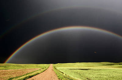 Rain Digital Art - Rainbow And Darkened Skies Seen Down A Country Road by Mark Duffy