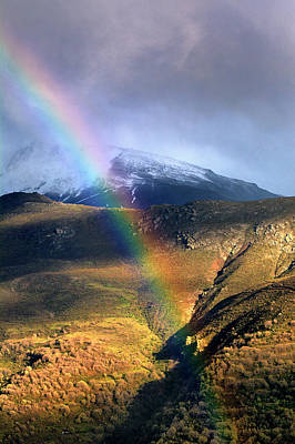 Rainbow Through The Snow Mountains Into The Storm Print by Guido Montanes Castillo