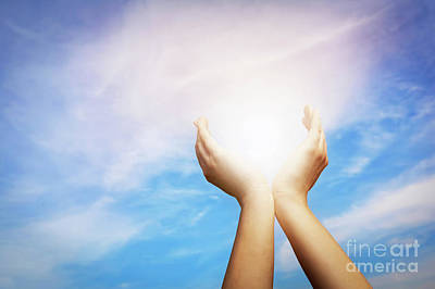 Happy Photograph - Raised Hands Catching Sun On Blue Sky. Concept Of Spirituality,  by Michal Bednarek
