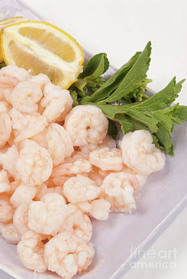 Photograph - Raw Uncooked Shrimp And A Lemon Wedge by Vizual Studio