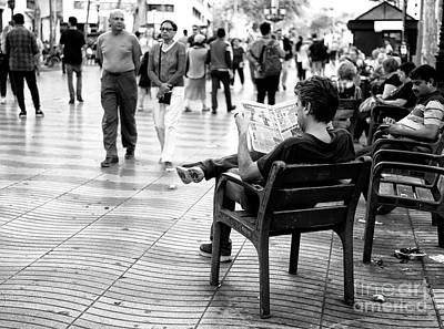 Photograph - Reading A Newspaper On La Rambla by John Rizzuto