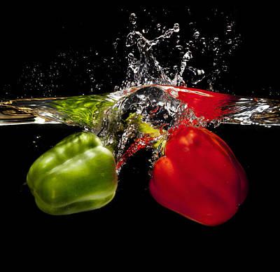 Red And Green Pepper Splash Art Print by Ian Moran