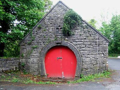 Red Barn Door In Ireland Art Print by Jeanette Oberholtzer