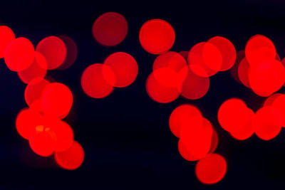 Photograph - Red Blurred Celebration Fairy Lights by John Williams