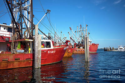 Art Print featuring the photograph Red Boats In The Bay by John Rizzuto