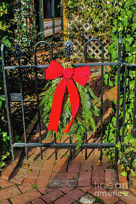 Photograph - Red Bow On Rod Iron Gate by Sandy Moulder