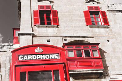 Photograph - Red British Telephone Box And Red Shutter Windows, Malta by Jacek Wojnarowski