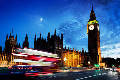 Photograph - Red Bus, Big Ben And Westminster Palace In London, The Uk. At Night. Moon Shining by Michal Bednarek