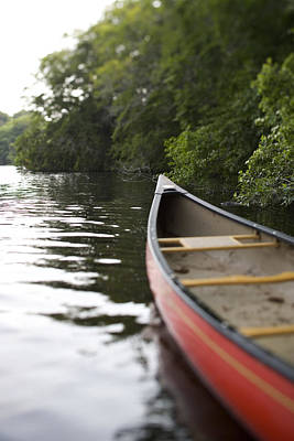 Canoe Photograph - Red Canoe At Shoreline With Trees by Gillham Studios