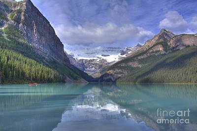 Red Canoe On Lake Louise Print by Larry Whiting