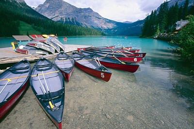 For Rent Photograph - Red Canoes At A Dock Emerald Lake by George Oze