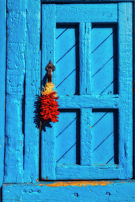 Of Painted Door Photograph - Red Chilis Hanging On Blue Door by Garry Gay