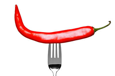 Red Chilli Pepper On A Fork Isolated On White Art Print by Richard Thomas