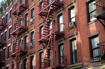 Photograph - Red Escape In The Village by John Rizzuto