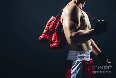Photograph - Red Gloves Hanging On The Boxer's Back. by Michal Bednarek