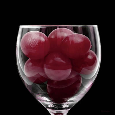 Red Grapes In Glass Art Print by Wim Lanclus