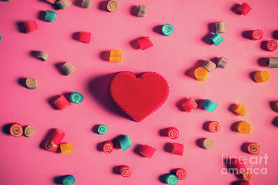 Photograph - Red Heart Surrounded By Candies On A Pink Background. by Michal Bednarek