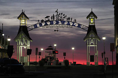 Photograph - Red Horizon Thru The Boardwalk Arch by Robert Banach