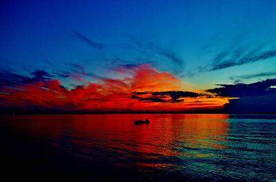 Photograph - Red Horizon Clouds With Deep Blue Sky Above Reflecting Off A Fairly Calm Indian River Bay by William Bartholomew