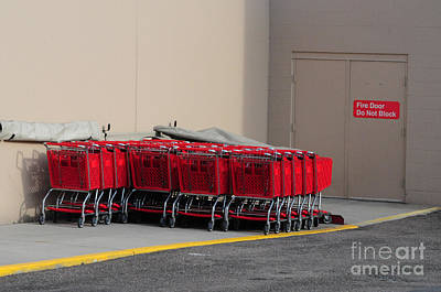 Mick Jagger - Red Shopping Carts in a row by Merrimon Crawford