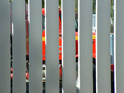 Photograph - Red Truck Through A 2x6 Fence by Stan  Magnan